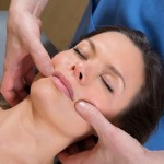 Facial tuina massAge therapy on beutiful woman face by therapist